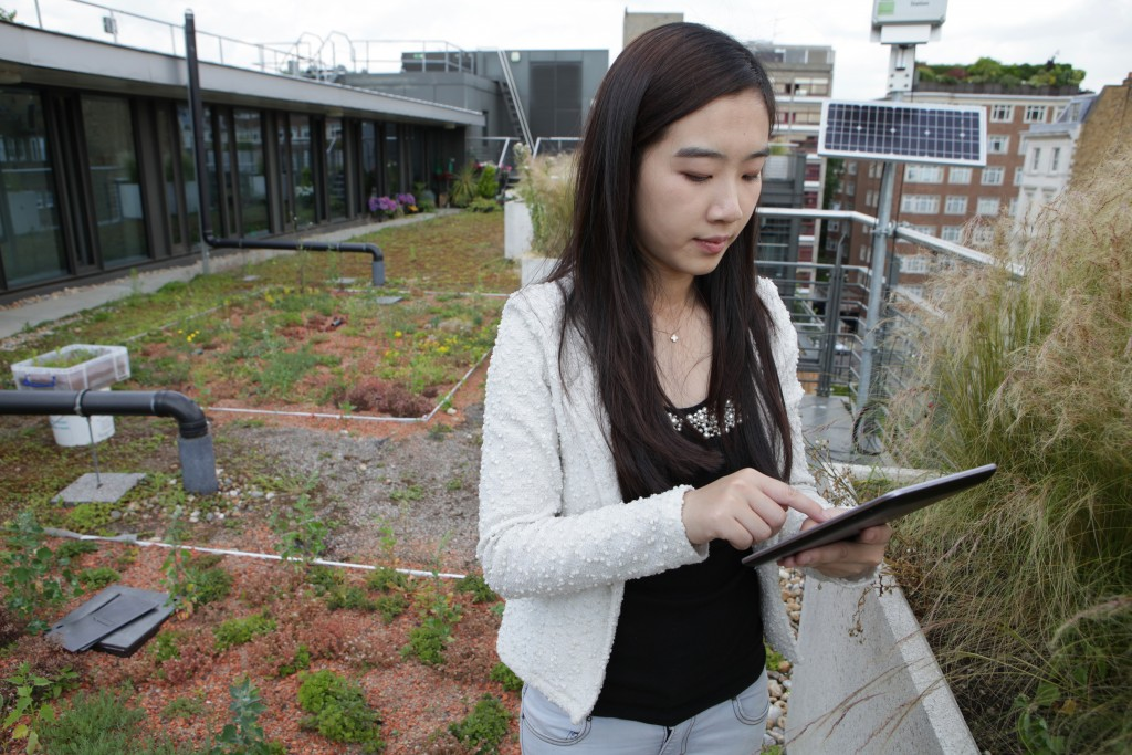 PhD Student Xi Liu on the green roof at Eastside, Imperial College London